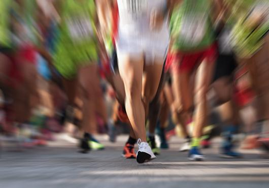 blurred image of runners' legs