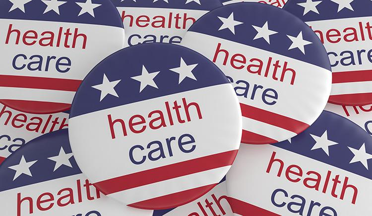 Multiple political buttons with U.S. flag and health care printed on them