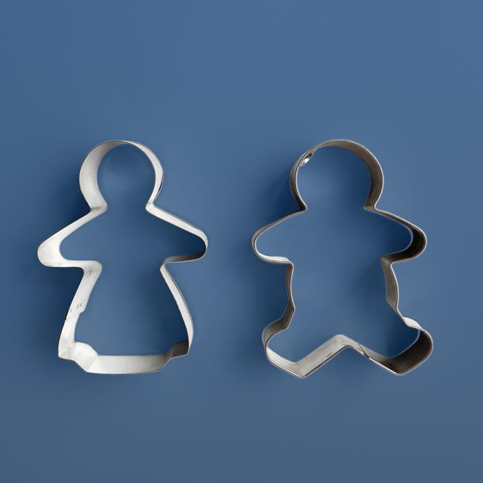 gingerbread cookie cutters in the form of a man and a woman