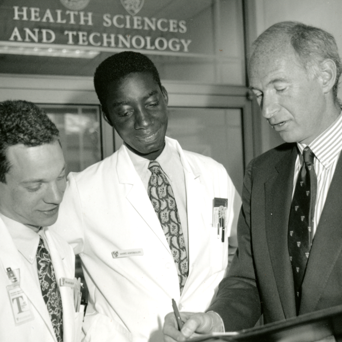 Michael Rosenblatt talks with two medical students, circa 1990s