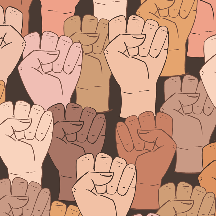 collection of ethnically diverse raised fists
