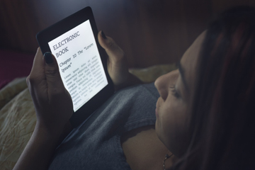 Image result for reading at night with kindle