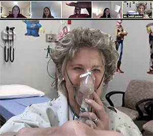 MEDscience Executive Director Julie Joyal gets into the act as Ms. Smith, a patient in a virtual medical simulation.